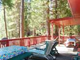 This Yosemite vacation rental has a huge family deck overlooking the Merced River