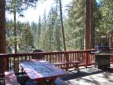 This Yosemite rental cabin has a convenient picnic table and plenty of seating for relaxing and family dinners outside