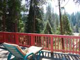 This Yosemite Forest cabin for rent has comfortable seating on the deck and great views of the Merced River