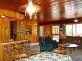 Large family dinner table in the dining area of this beautiful Yosemite National Park Rental Cabin